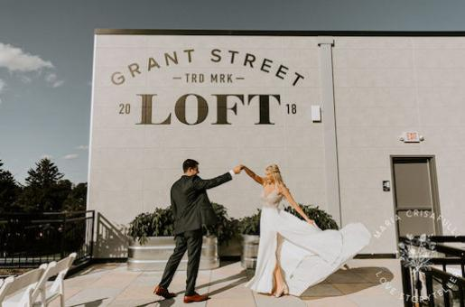 Bride and groom dancing on outside roof patio